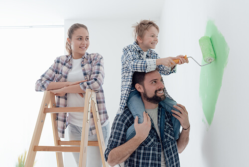 fort collins family painting a wall